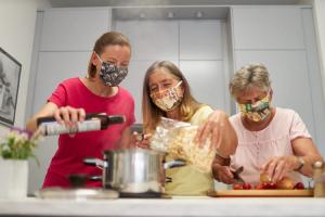3 people wearing masks cooking dinner-Richardson Custom Homes-Fort Myers300x200jpg