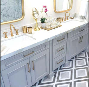 Bathroom with gold fixtures-7 Design Trends to Carry into the New Year-Richardson Custom Homes-Fort Myers-300x296jpg