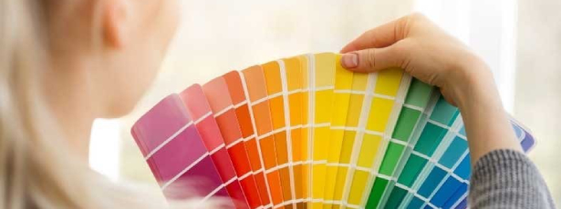 Lady with color fan-7 tips to choosing paint colors-Richardson Custom Homes-Fort Myers615x230jpg