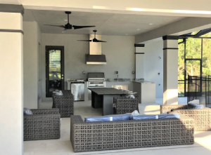 Lanai with outdoor furniture and kitchen-5 Ideas for Safer Holiday Gatherings-Richardson Custom Homes-Fort Myers300x221jpg