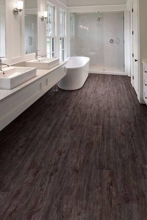 Luxury vinyl tile floor in bathroom--Richardson Custom Homes-Fort Myers-300x450jpg