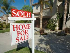 SOLD sign in front of home-Pandemic Impact On SW Florida Real Estate-Richardson Custom Homes-Fort Myers-300x225jpg