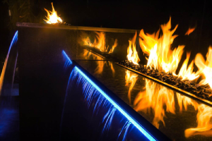 nighttime-fire-and-water-feature-in-pool-Five-Fire-Features-to-Brighten-Any-Home-Richardson-Custom-Homes-Fort-Myers–300x200jpg.jpg