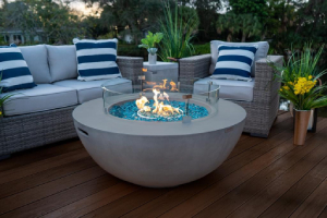 outdoor living room with modern glass and concrete fire bowl-Richardson Custom Homes-Fort Myers–300x200jpg