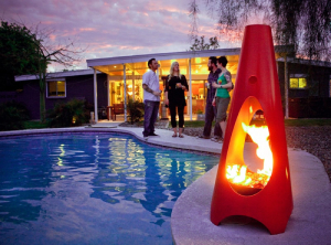 red modern design chimenea outside by pool-Five Fire Features to Brighten Any Home-Richardson Custom Homes-Fort Myers–300x222jpg