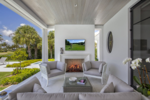 seaside outdoor living room with built in fireplace-Five Fire Features to Brighten Any Home-Richardson Custom Homes-Fort Myers–300x200jpg