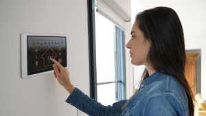 woman using smart appliance-7 design trends to carry into the new year-Richardson Custom Homes-Fort Myers-300x169jpg